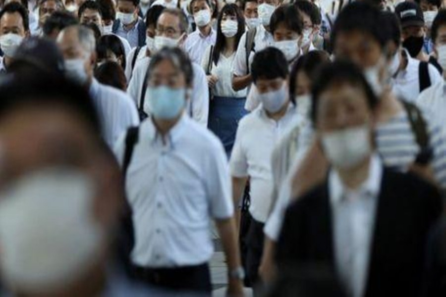 Commuters wearing face masks arrive at Shinagawa Station at the start of the working day amid the coronavirus disease (COVID-19) outbreak, in Tokyo, Japan, August 2, 2021. Reuters/ Kevin Coombs