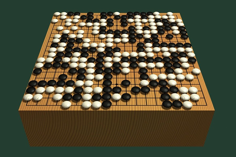 The game, Go, is designed in rich categories with simple rules and regulations with a traditional, carved wooden board, with black and white stones made from slate and clamshell — Internet photo