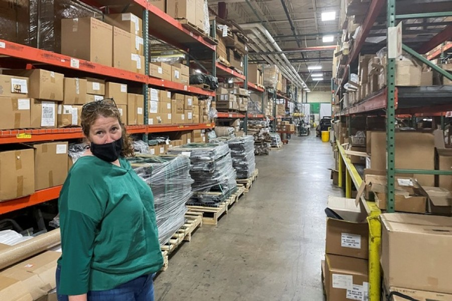 Diamond Brand COO Lauren Rash stands in an aisle of shelves with stockpiled parts as the 'lean' supply management has been upended by global shortages and bottlenecks, at Diamond Brand factory in Fletcher, outside Asheville, North Carolina, US August 11, 2021. Reuters