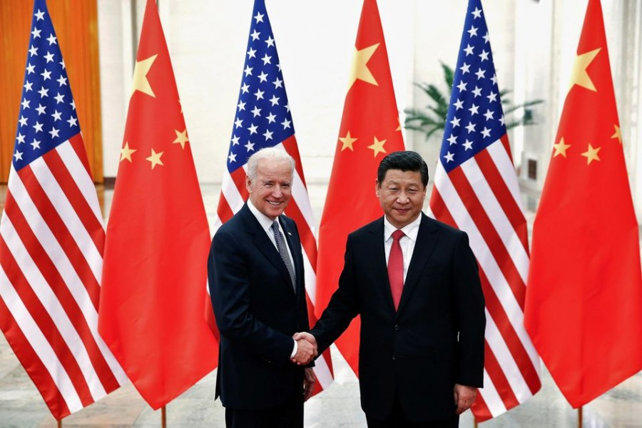 Chinese President Xi Jinping shakes hands with US Vice President Joe Biden (L) inside the Great Hall of the People in Beijing December 4, 2013. REUTERS/Lintao Zhang/Pool