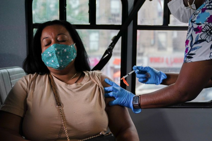 A person receives a dose of the Pfizer-BioNTech vaccine for the coronavirus disease (COVID-19), at a mobile inoculation site in the Bronx borough of New York City, New York, US, August 18, 2021. REUTERS/David 'Dee' Delgado/File Photo