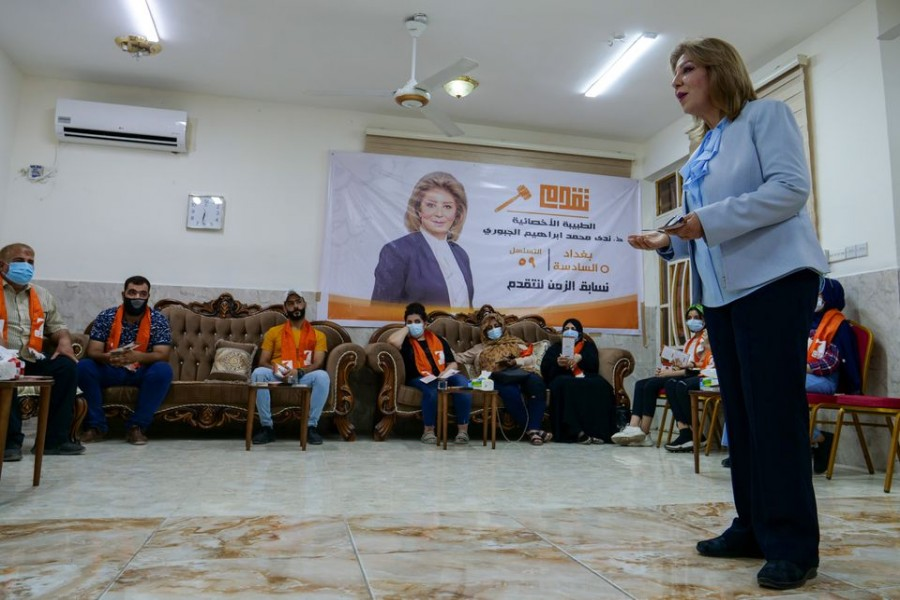 Nada al-Jubori, a candidate in Iraq's upcoming parliamentary elections, speaks to her supporters in Baghdad, Iraq September 9, 2021 — Reuters