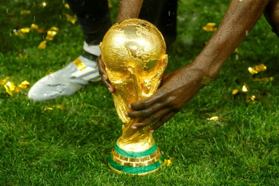 Soccer Football - World Cup - Final - France v Croatia - Luzhniki Stadium, Moscow, Russia - July 15, 2018 General view of the trophy as France celebrate after winning the World Cup REUTERS/Kai Pfaffenbach/File Photo