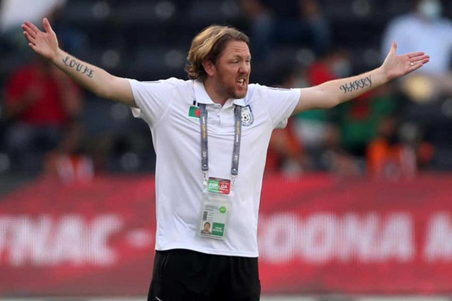 Football federation puts coach Jamie Day on forced leave