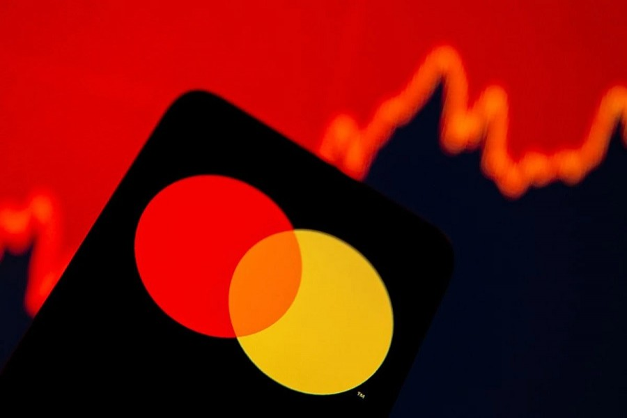 Smartphone with Mastercard logo is seen in front of displayed stock graph in this illustration taken, July 15, 2021— Reuters/Dado Ruvic/Illustration/File Photo