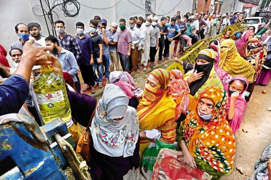 People waiting in queues to buy daily commodities at a TCB sales point near the National Press Club in the city on June 17 this year –FE file photo